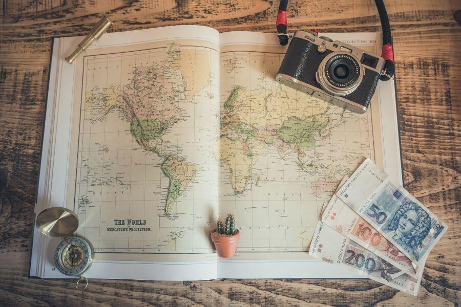 map, compass, camera flatlay